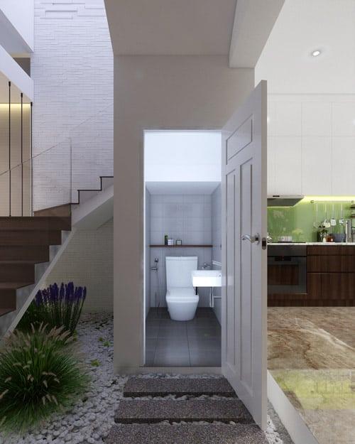 Phòng vệ sinh phân chia ranh giới giữa phòng khách và bếp.